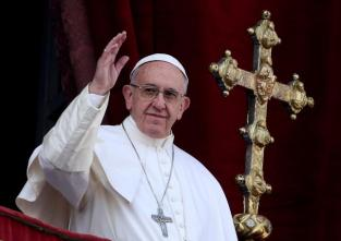 FILE PHOTO: Pope Francis waves after delivering his